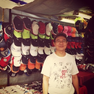 Mr Tng sells an array of sports caps, every colour, every brand.