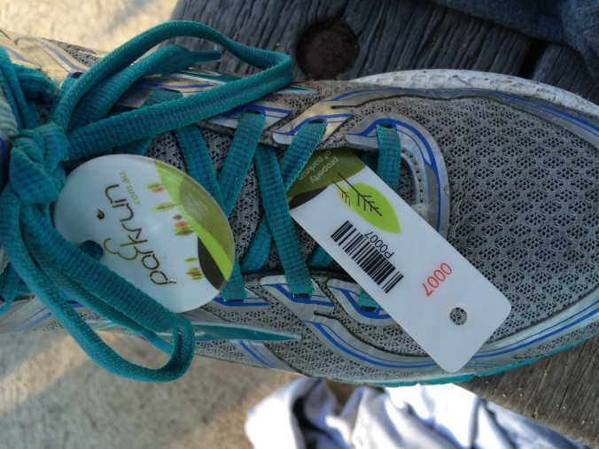 Barcode tag on shoe with finisher token.